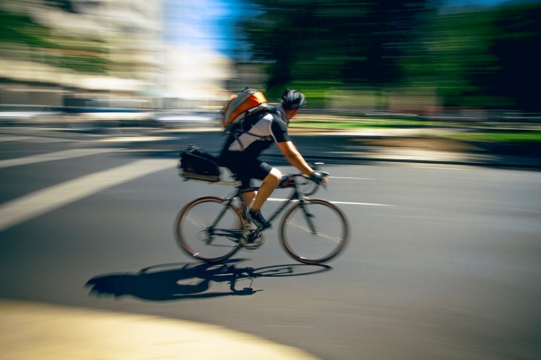 A bicyclist pedals by