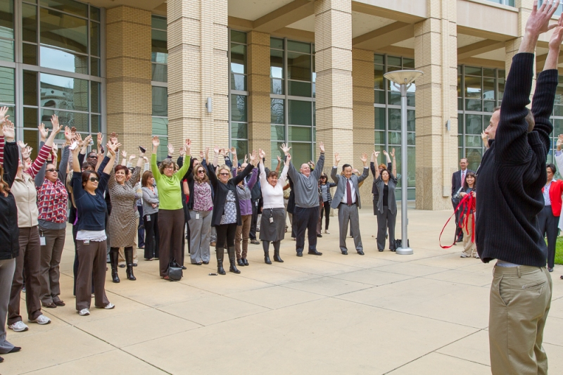 Led by Kaiser Representatives, city employees stretch it out before embarking on their walk around city hall on Wednesday, February 19.