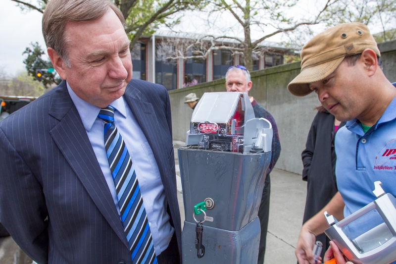 City Manager John Shirey caught up with the installers of new smart meters at the county courthouse