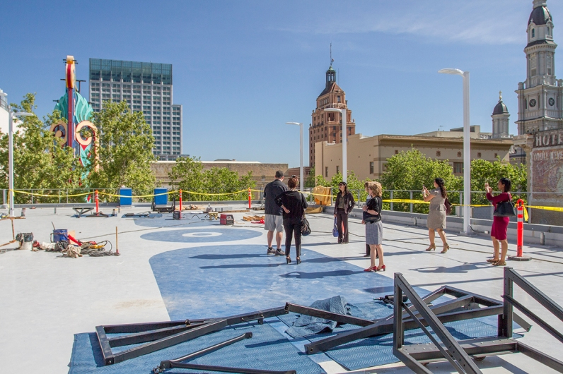 The facility includes a roof-top basketball court that has amazing views of the central city.