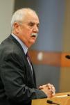 City Treasurer Russ Fehr pours over details regarding financing the project.