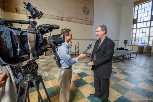 Greg Taylor, project manager, interviewed by the media.