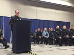 Chief Sam Somers addressing the academy graduates and the families