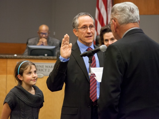 Newly elected Council Member Jeff Harris is sworn into office.