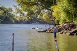 Fishermen enjoy a warm Sacramento River.