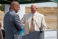 Kevin Johnson welcomes developer Larry Kelley to speak upon the Kaiser hospital.