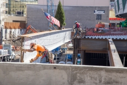 Workers install the last beam